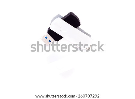 usb stick or flash drive representing data concepts with shadow and reflection on white background - stock photo