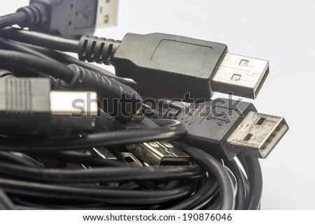 USB Tangle/ a coil of old used random usb cords  - stock photo