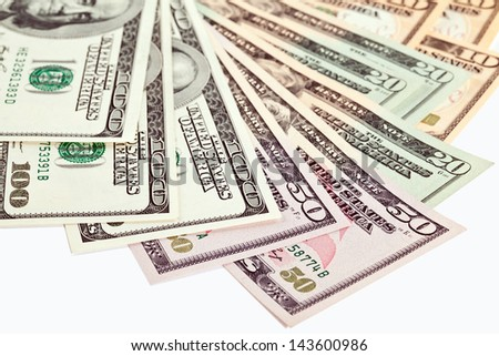 USD currency; many dollar banknotes isolated over white - stock photo