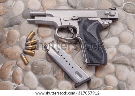 Use Modern handgun M9 close-up.on a rock background. - stock photo