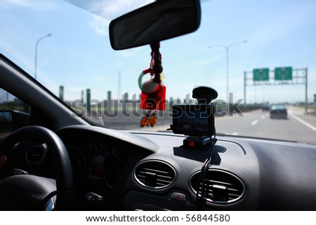 Use of GPS satellite positioning system on the highway - stock photo