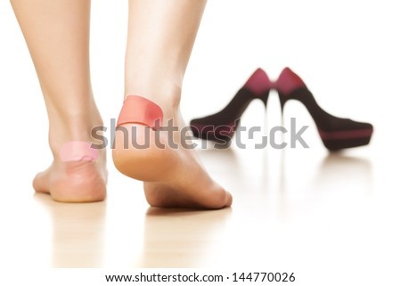 use of sticky plasters due to tight footwear - stock photo