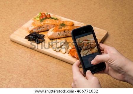 Use smart phone taking photo Before Meals Grilled Salmon Steaks