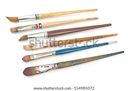 Used artist brushes isolated on white - stock photo