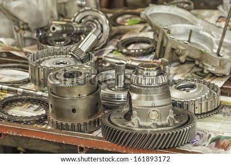 Used automatic transmission parts on a workbench. - stock photo