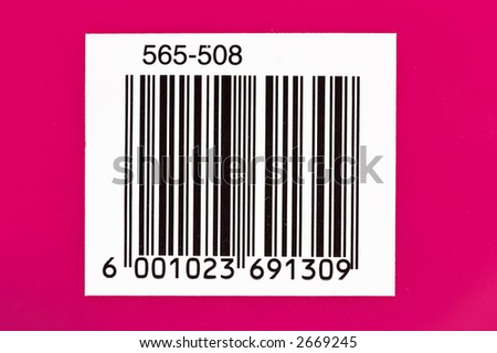 Used barcode on a pink background with numbers - stock photo