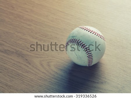 used baseball on wooden  - vintage filter - stock photo