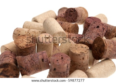 Used corks from bottles guilt isolated white background. - stock photo
