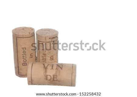 Used corks isolated on white background - stock photo