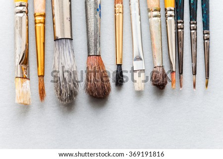 Used different size paint brushes. retro style wooden paintbrush texture. top view, soft focus, close-up photo - stock photo
