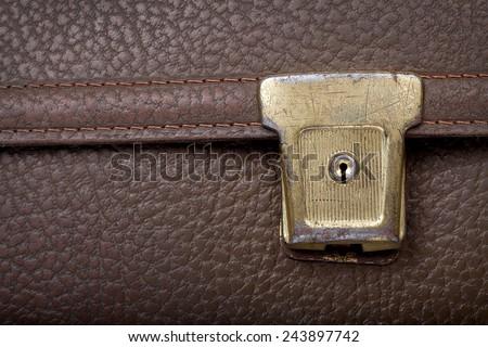 used golden lock on brown leather school bag, retro, copyspace - stock photo