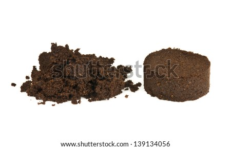 used ground coffee tablet and coffee powder