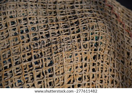 Used industrial ropes lake with fishing nets. - stock photo