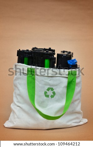 Used laser printer toner in a recycle bag - stock photo