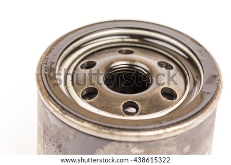 Used old car oil filter - stock photo
