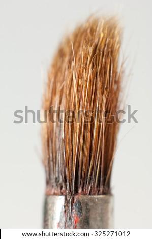 Used paint brush. - stock photo