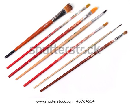 Used paintbrushes over white - stock photo