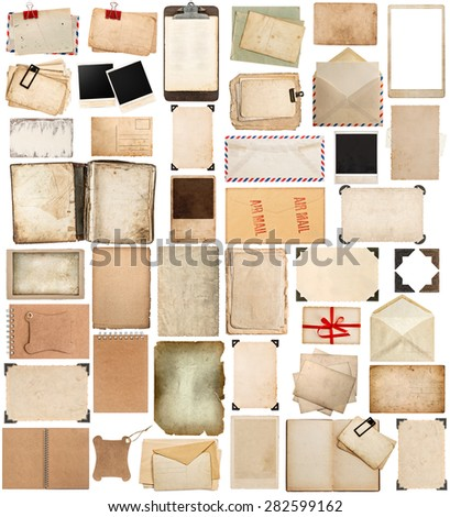 Used paper sheets, books, pages and old postcards, antique clipboard and photo corner isolated on white background. Vintage photo frames. - stock photo