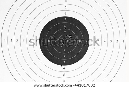 Used paper target with bullet holes. - stock photo