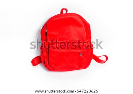 Used red school backpack isolated on white background.Travel bags.