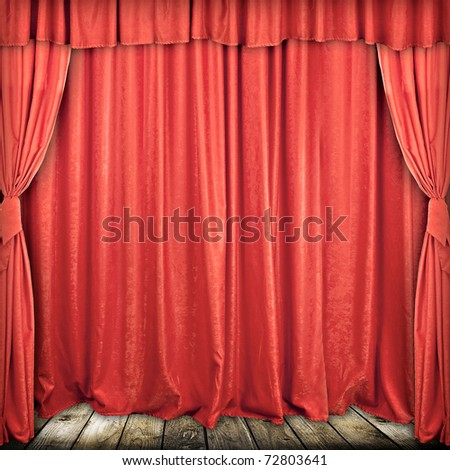Used red stage curtain with light and shadow - stock photo