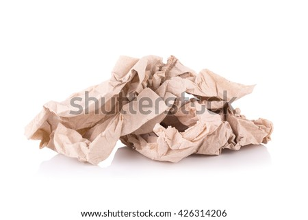 Used screwed brown paper tissue isolated on white background. - stock photo