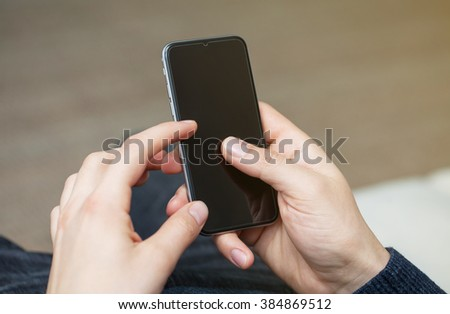 used the phone in the hand of a man for a set of messages - stock photo