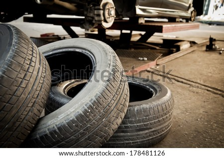 Used tire replacement from car. Processed with vintage style. - stock photo