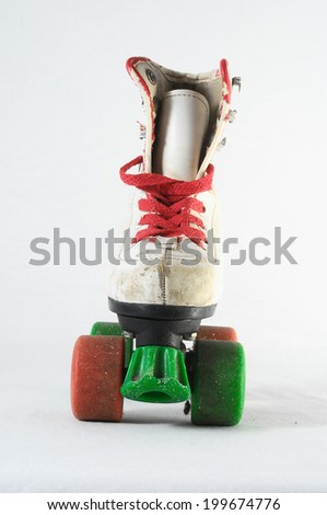 Used Vintage Consumed Roller Skate on a White Background - stock photo