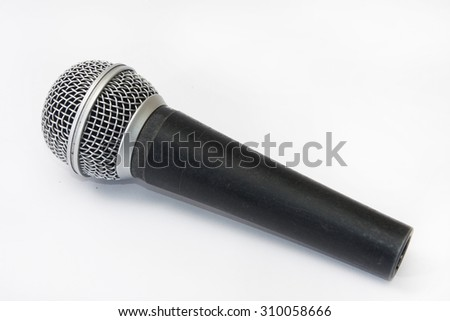 Used vocal microphone on the white background. - stock photo