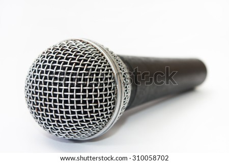 Used vocal microphone on the white background.
