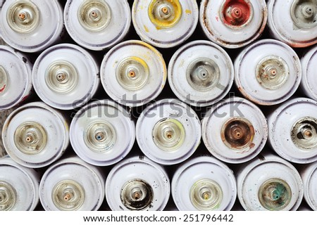 used white graffity spray cans - stock photo