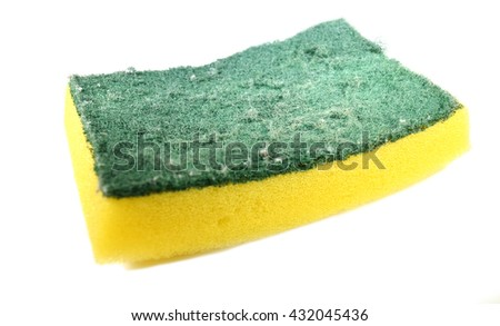Used yellow sponge with dark green scrubber - isolated - stock photo