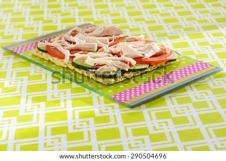 Useful sandwich from vegetables and chicken breast on crispbread