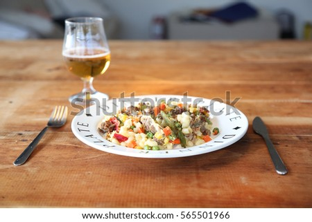Useful vegetable casserole in a bowl on a wooden background. Proper nutrition.