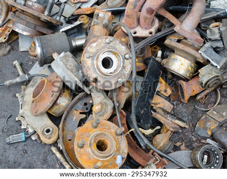 Useless, worn out rusty brake discs and other parts - stock photo