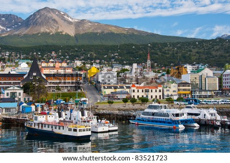 Ushuaia Harbor, Tierra del Fuego. Boats line the harbor in Ushuaia, southernmost city in the world and the leading port for Antarctic exploration. - stock photo