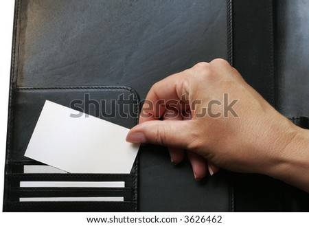using a black leather portfolio (also called a folder), a woman displays blank business cards - stock photo