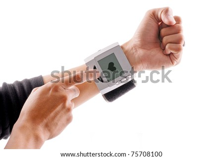 Using a Blood Pressure Wrist Monitor - stock photo