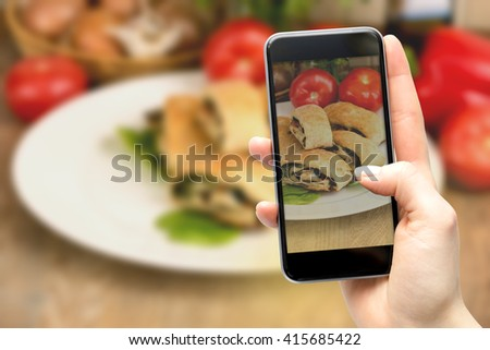 Using a smartphone to take pictures of food. - stock photo