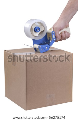 Using a tape dispenser to seal a shipping box - stock photo