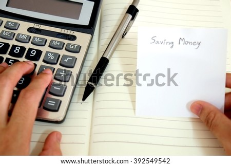 using calculator, saving money concept