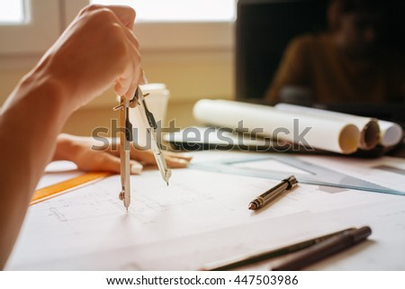 Using compass divider for a technical drawing - stock photo