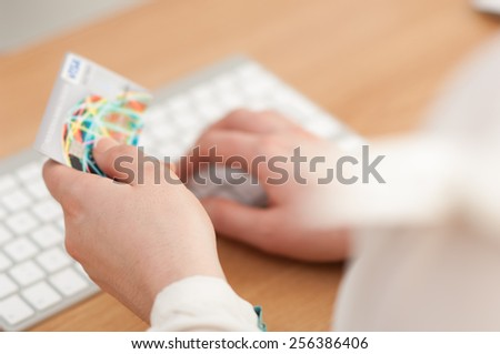 Using computer and credit card for online payment. - stock photo