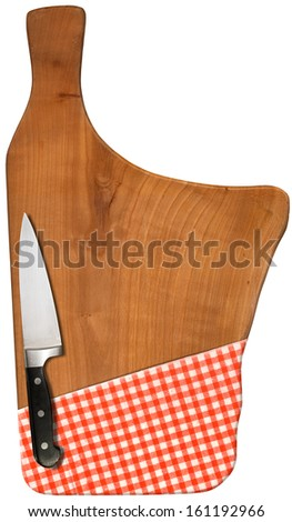 Using Cutting Board with Knife and Tablecloth / Used chopping or cutting board isolated on white with red checked tablecloth and kitchen knife   - stock photo