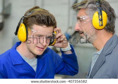 using earmuffs - stock photo