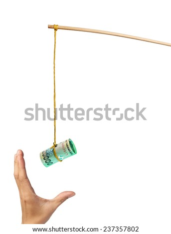 Using Indonesian rupiah as a bait depicting greed, isolated on white background  - stock photo