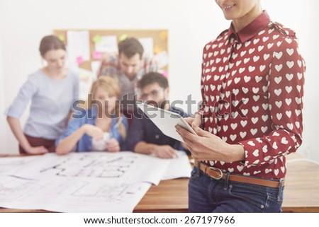 Using modern technology in work - stock photo