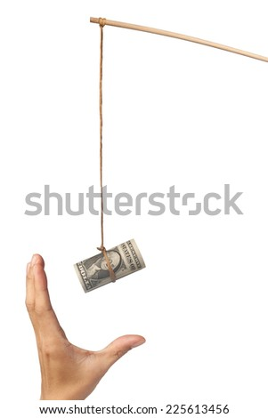 Using money as a bait depicting greed, isolated on white background  - stock photo