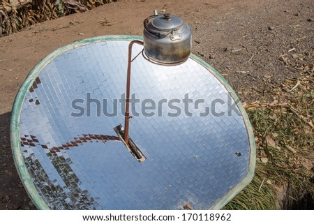Using solar power to boil a kettle - stock photo